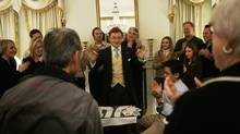 "Magician Steve Cohen, center, performs his ""Chamber Magic"" show at The Waldorf Hotel Friday, Dec. 22, 2006 in New York. (Mary Altaffer/AP)"