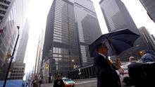 Business people are seen at the intersection of King and Bay Streets in Toronto, Ontario, Wednesday, October 15, 2014. (Kevin Van Paassen for The Globe and Mail)