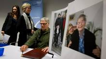 Lee Carter, left, and her husband Hollis Johnson leave a news conference where photos of Carter's mother, Kay Carter, are shown in Vancouver in April 2011. (Darryl Dyck for The Globe and Mail)