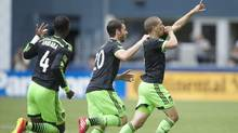 Seattle Sounders' Osvaldo Alonso celebrates scoring a goal against Tottenham Hotspur (Stephen Brashear/AP Photo)