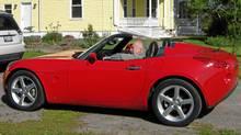 Bernie Finkelstein in his Solstice roadster. (Elizabeth Blomme)