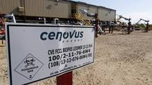 A warning sign is pictured near wellheads that inject steam into the ground and pump oil out at the Cenovus Energy Christina Lake Steam-Assisted Gravity Drainage (SAGD) project 120 km south of Fort McMurray, Alta. (Todd Korol/Reuters)