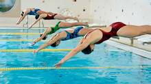 Women swimmers competing in race (Jupiterimages/(c) Jupiterimages)
