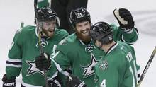 In this 2015 file photo, Dallas Stars left wing Jamie Benn (14) celebrates his goal with teammates Alex Goligoski and Jordie Benn (24) during overtime play of an NHL hockey game against the Vancouver Canucks. (LM Otero/THE ASSOCIATED PRESS)