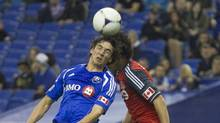 Montreal Impact's Zarek Valentin (19) fights for the ball with Toronto FC's Logan Emory (R) during the first half of their MLS soccer match in Montreal, Quebec April 7, 2012. (CHRISTINNE MUSCHI/CHRISTINNE MUSCHI/REUTERS)