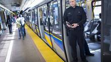 Constable Graham Walker with Transit Police at the Sapperton Station in New Westminster with a non-working version of a new sexual-offence reporting app. Transit Police are embarking on a week-long campaign targeting sexual offences on public transit across Metro Vancouver. (John Lehmann/The Globe and Mail)