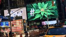 An electronic billboard displays a marijuana hashtag at Times Square in New York on Monday. (SHANNON STAPLETON/REUTERS)