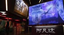 Advertisements for Avatar and a trailer showing the state-backed biopic Confucius at a cinema in Beijing are depicted in this file photo. (Ng Han Guan/AP)