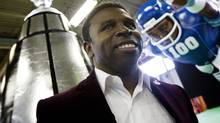 "Former Toronto Argonaut Mike ""Pinball"" Clemons listens to the speakers at a Santa Claus Parade media day. (Peter Power/The Globe and Mail)"