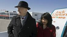 NDP leader Jack Layton and his wife Olivia Chow stand on the steps of the campaign plane as he heads out in Ottawa on Saturday, March 26, 2011. (Andrew Vaughan/The Canadian Press/Andrew Vaughan/The Canadian Press)
