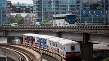 A Skytrain, shown in Vancouver in June, 2016, is just one kind of transit that has contributed to urban densification. (Ben Nelms/The Globe and Mail)