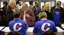 Supports line to get their pre-approved passes to a Conservative election rally in Hamilton on April 7, 2011. (Moe Doiron/Moe Doiron/The Globe and Mail)