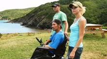 Chris MacKinnon and his wife, Eileen MacLellan, swam, hiked and forded their way to Eileen's father, Kenneth, who uses a wheelchair. (Paul Darrow for The Globe and Mail)