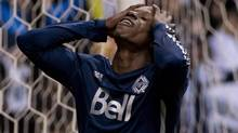 Vancouver Whitecaps FC Darren Mattocks reacts to missing a shot during the first half against the Colorado Rapids MLS action in Vancouver, Saturday, April 5, 2013. (JONATHAN HAYWARD/THE CANADIAN PRESS)