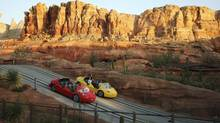 Park visitors can reach up to 72 km/h on the Radiator Springs Racers, and dine in Flo's V8 café. (DAVID MCNEW/REUTERS)