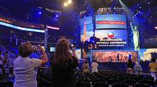 Visitors take photos of the main stage during the public unveiling of Democratic National Convention's facilities at Time Warner Arena in Charlotte, N.C., Friday, Aug. 31, 2012. (Chuck Burton/AP)