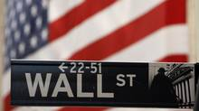 A Wall Street sign is seen outside of the New York Stock Exchange. (LUCAS JACKSON/REUTERS)