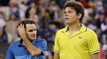 Milos Raonic, right, of Canada and Roger Federer of Switzerland walk off the court after Federer defeated Raonic in three sets during their match at the Indian Wells ATP tennis tournament in Indian Wells, Calif., on March 13, 2012. (DANNY MOLOSHOK/Danny Moloshok/Reuters)