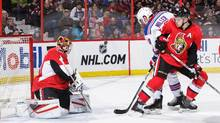 Craig Anderson #41 of the Ottawa Senators tracks the puck as team mate Mark Borowiecki #74 defends against J.T. Miller #10 of the New York Rangers during an NHL game at Canadian Tire Centre on January 24, 2016 in Ottawa, Ont. (Jana Chytilova/Freestyle Photo/Getty Images)