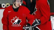 Mark Scheifele, left, from Kitchener, Ont., skates onto the ice with Ryan Nugent-Hopkins, from Burnaby, B.C., during National Juniors selection camp in Calgary, Alta., Tuesday, Dec. 11, 2012. A year ago, Scheifele declared he wanted to be Canada's number-one centre at the world junior hockey championship. It appears the Winnipeg Jets prospect will be on Canada's top line this year, but on the right wing of Ryan Nugent-Hopkins. (Jeff McIntosh/THE CANADIAN PRESS)