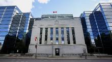 "It's been the Bank of Canada's position to look through both the currency and oil-price effects on inflation as ""transitory"" factors, and consider underlying inflationary pressures aside from them – which continue to look pretty tame, given a sluggish economy that still has ample spare capacity. (Patrick Doyle/Bloomberg)"