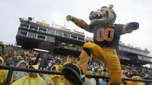 The Hamilton Tiger-Cats' mascot 'T.C.' cheers during a game against the Winnipeg Blue Bombers play at Ivor Wynne Stadium in Hamilton, ON, on Saturday, October 27, 2012. This may be the final CFL game played in the stadium. (Matthew Sherwood/The Globe and Mail)