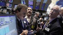Traders work the floor of the New York Stock Exchange on Wednesday, Nov. 30. (Richard Drew/Richard Drew/AP)