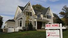 A real estate sign advertising a home for sale is pictured in Vienna, Virginia, U.S. (LARRY DOWNING)