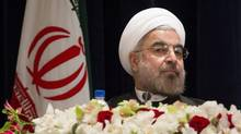 Iranian President Hasan Rouhani takes his chair before a news conference in Manhattan on Sept. 27, 2013. The developed world is hungry for new markets, and a post-sanction Iran could satisfy those urges. (John Minchillo/AP)