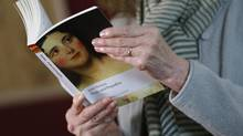 """Jane Austen expert Hazel Jones reads from Austen's novel """"Pride and Prejudice"""" during a twelve hour live readathon at the Jane Austen Center in Bath, southern England January 28, 2013. Former Bank of Canada Governor Mark Carney faces the issue of whether Austen should replace Charles Darwin on Britain's 10 pound note. (SUZANNE PLUNKETT/REUTERS)"""