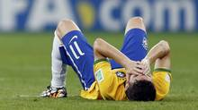 Brazil's Oscar reacts after their loss to Germany in their 2014 World Cup semi-finals on July 8, 2014. (MARCOS BRINDICCI/REUTERS)