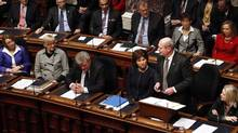 B.C. Finance Minister Mike de Jong tables the provincial budget in the Legislative Assembly, Tuesday, February 18, 2014 in Victoria, B.C.