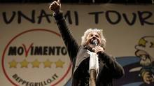 Five Star Movement leader and comedian Beppe Grillo whips up the crowd during a rally in Rome Feb. 22, 2013. Mr. Grillo says the overwhelming number of feckless, corrupt politicians who are grinding Italy to dust have to be swept out. (MAX ROSSI/REUTERS)