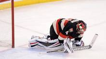 Ottawa Senators' Craig Anderson kneels on the ice after letting in a goal (Sean Kilpatrick/THE CANADIAN PRESS)