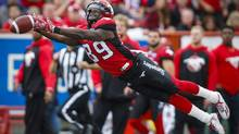 Calgary Stampeders' DaVaris Daniels has the ball slip through his fingers during CFL football action against the Ottawa Redblacks on Sept. 17, 2016. (Jeff McIntosh/The Canadian Press)