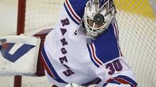 New York Rangers goalie Henrik Lundqvist dives for the puck (Jeff McIntosh/THE CANADIAN PRESS)