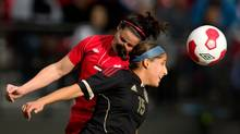 Mexico's Guadalupe Worbis, right, and Canada's Rhian Wilkinson vie for the ball during the first half of a women's international friendly soccer game in Vancouver, B.C., on Sunday November 24, 2013. (DARRYL DYCK/THE CANADIAN PRESS)