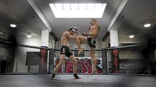 Murray Sogen, left, and Tak Sasaki practise their craft at Tactix Gym in Vancouver on Monday. (Ben Nelms for The Globe and Mail/Ben Nelms for The Globe and Mail)
