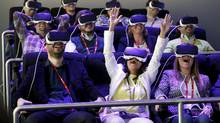 People test Samsung Virtual Reality glasses during the Mobile World Congress in Barcelona, Spain. (Albert Gea/Reuters)