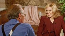 Larry King chats with Madonna, Sept. 30, 2002. (Chris Pizzello / AFP)