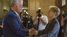 Kathleen Wynne and Philippe Couillard are meeting in Toronto on Friday for a joint cabinet session. Officials confirmed that Energy East will be on the agenda, and the premiers plan to release a joint statement on the project. (Clément Allard/The Canadian Press)