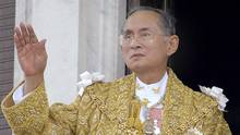In this June 9, 2006, file photo released by the Thai Government Public Relations Department, Thailand King Bhumibol Adulyadej acknowledges the crowd in Bangkok during the celebrations of the 60th anniversary of his accession to the throne. Thailand's Royal Palace said on Thursday, Oct. 13, 2016, that Thailand's King Bhumibol, the world's longest-reigning monarch, has died at age 88. (AP)