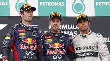 Red Bull drivers Mark Webber and Sebastian Vettel and Mercedes driver Lewis Hamilton on the podium in Malaysia (Vincent Thian/The Associated Press)