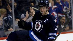 Winnipeg Jets' Andrew Ladd celebrates after scoring his second goal of the game against the Tampa Bay Lightnings during second period NHL hockey action in Winnipeg, Tuesday, April 16, 2013.