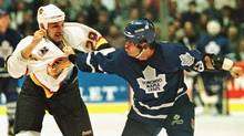 Gino Odjick, left, of the Vancouver Canucks and Tie Domi of the Toronto Maple Leafs fight during an NHL game on Nov. 3, 1995, in Vancouver. (Jeff Vinnick/Reuters)