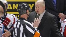 Washington Capitals coach Bruce Bouddreau (R) argues with referee Dan O'Rourke during the second period of play against the Montreal Canadiens in Game 4 of their NHL Eastern Conference quarter-final hockey series in Montreal, April 21, 2010. (SHAUN BEST/REUTERS)