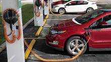 Chevrolet Volt cars are parked at a solar-powered electric charging station in Hamtramck, Mich. (REBECCA COOK/Reuters)