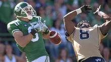 Blue Bombers defensive back Chris Randle block a pass intended for Saskatchewan Roughriders wide receiver Rob Bagg during the 2nd quarter of CFL action in Regina, Sask., Sunday, August 31, 2014. (Liam Richards/THE CANADIAN PRESS)