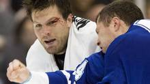 Toronto Maple Leafs defenceman Brad Brown (right) sends some blood flying as he connects with Ottawa Senators Brian McGrattan in a fight during first period NHL preseason action in Toronto on Wednesday Sept. 27, 2006. (The Canadian Press)