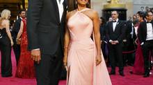 Actor Will Smith and wife Jada Pinkett Smith arrive on the red carpet at the 86th Academy Awards in Hollywood, Calif., on March 2. (MIKE BLAKE/REUTERS)